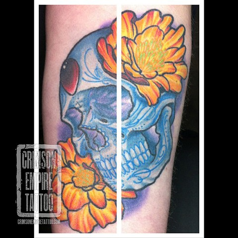 Blue skull and yellow flower on forearm by Jared Phair