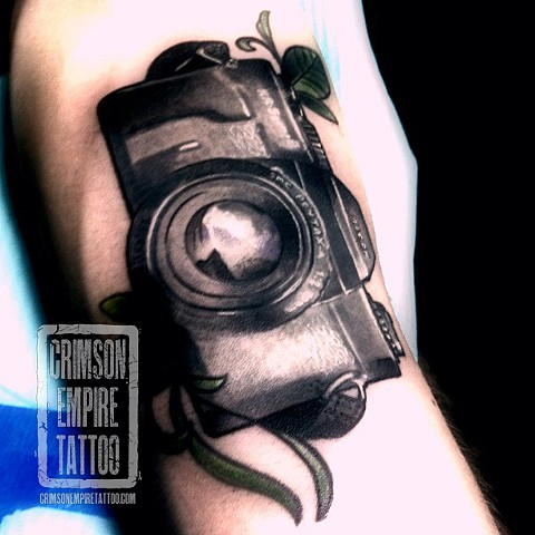 Pentax and vine on forearm by Chad Clothier