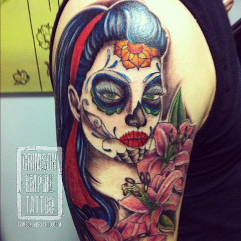 Sugarskull on bicep by Jessica Alther