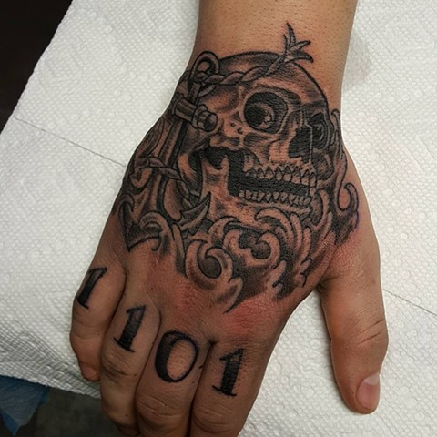Skull With Anchors And Script Tattoo By Sheila Anderson Black And Grey Crimson Empire Tattoo