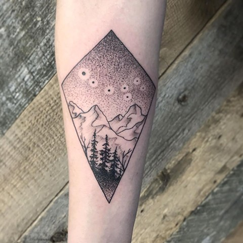 Geometric Mountains and Sky Arm Tattoo by Vanessa Spezowka Pointillism Crimson Empire Tattoo