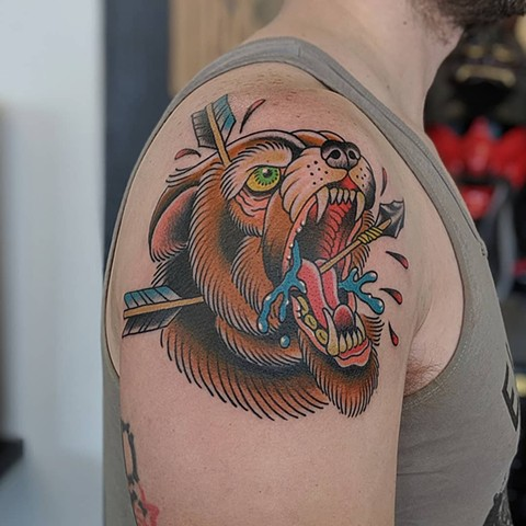Traditional Bear with Arrows Upper Arm tattoo by Chris Benson Color Crimson Empire Tattoo