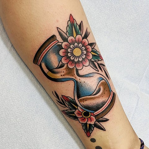 Traditional Hourglass and flowers Arm Tattoo by Chris Benson Color Crimson Empire Tattoo