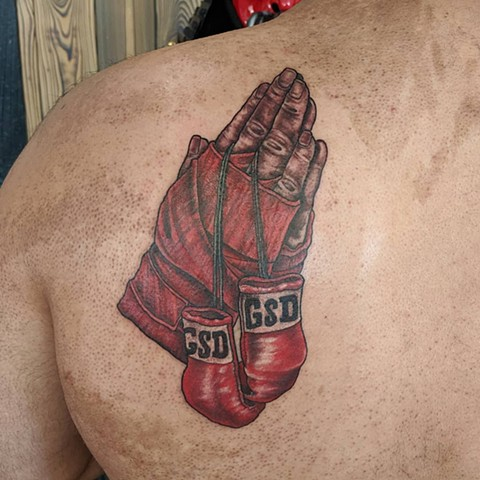 Praying Boxer Hands Back Tattoo by Sheila Anderson color Crimson Empire Tattoo