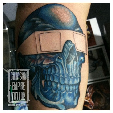 Blue skull with glasses on side by Josh Lamoureux