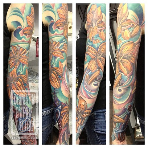 Flower sleeve on arm by Josh Lamoreux