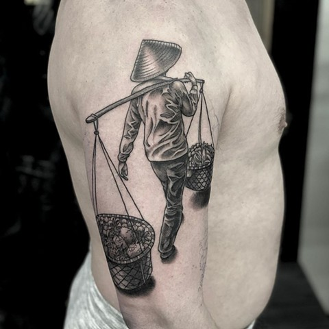 Woman Carrying Baskets Upper Arm Tattoo by Curt Semeniuk Black and Grey Crimson Empire Tattoo