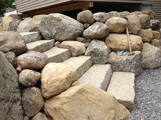 Cascading stone around antique granite steps