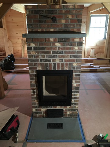 Brick faced masonry heater