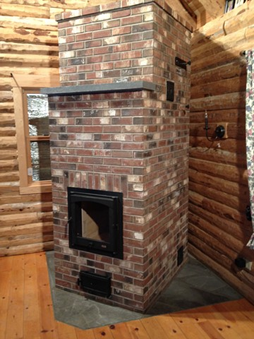 Double bell masonry wood stove