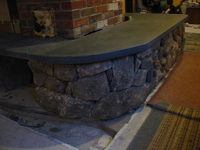 Wrap around stone bench