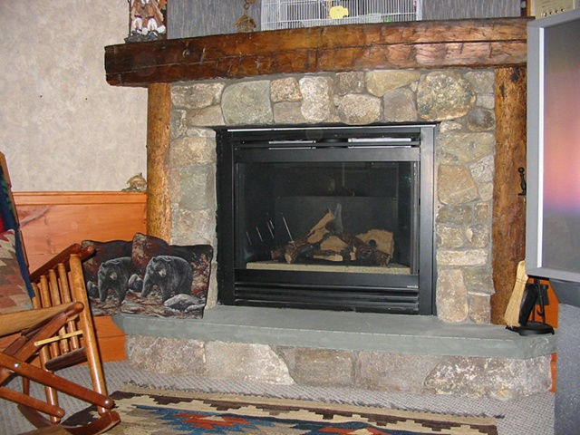 Stone faced gas fireplace
