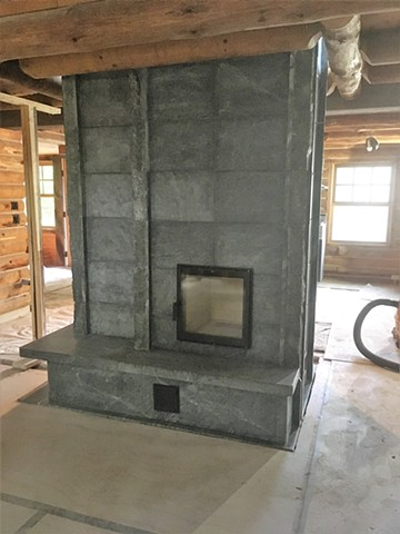 Custom soapstone masonry heater by Greenstone