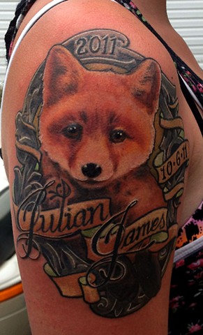 fox tattoo with ornamental frame by chris lowe of naked art tattoo
