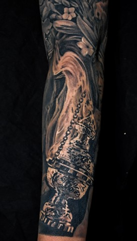 details of religious tattoo by chris lowe of naked art tattoos