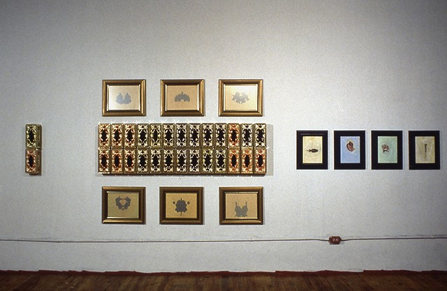 Jennifer McMackon, Rorschach Test Wall, arrangement of paintings and objects on a wall, detail, 1992