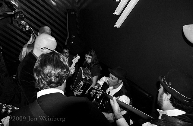 The band rehearsing in a tiny dressing room