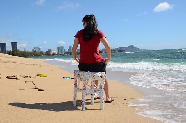 Hawaiian student Erika Drake plastic chair