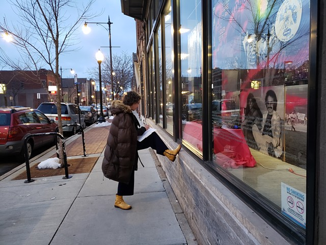 Lori reviewing Li-Ming Hu's submission, conveniently located in the windows on the other side of the Co-Prosperity Sphere