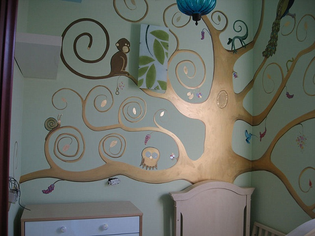 branches of nursery mural tree with monkey, owl, snail paint by the design deli