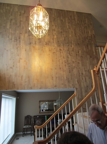 Metallic plaster troweled over custom metallic paint- two level foyer.