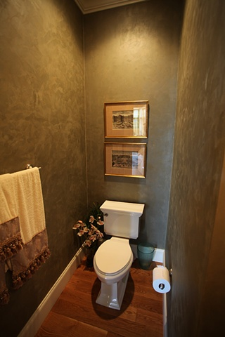 Burnished green plaster in powder room.