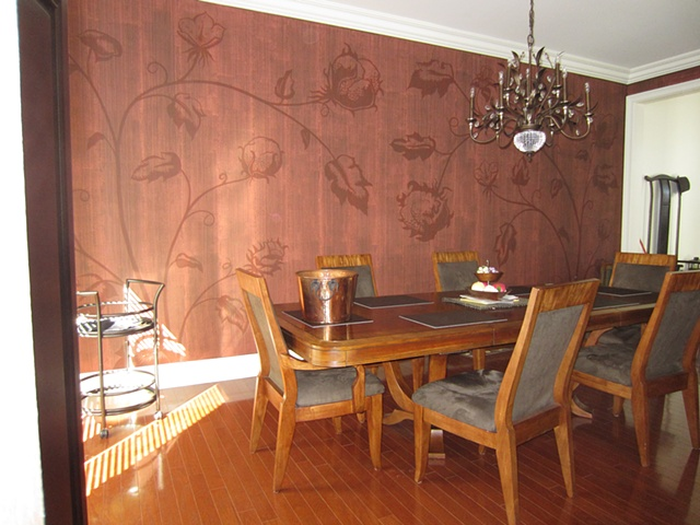 Freehand cotton plant motif with matte plaster striae overlay in dining room.