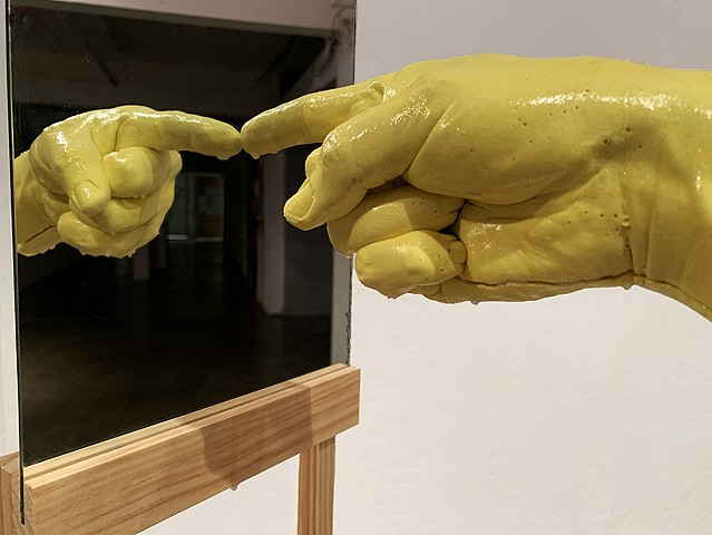 finger pointing, brian zimmerman, brain zimmerman, artist contemporary art cast hands, plaster hands, rickity wood, structure, yellow, pointing blame mirror, sculpture