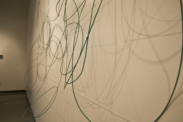 Detail of shadows, wire, and fishing line