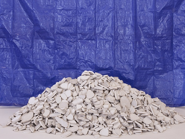 photograph of sculpture of drywall rubble pile by Rena Leinberger