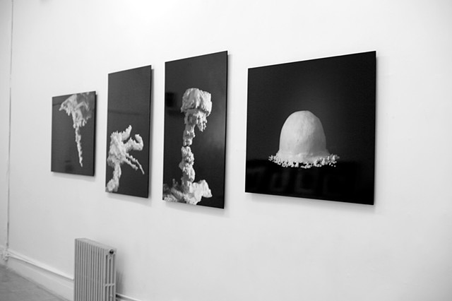 installation view of frosting photos of recreated atomic bomb explosions