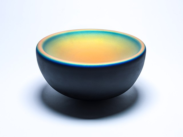 decorative handblown glass bowl with iridescent coating