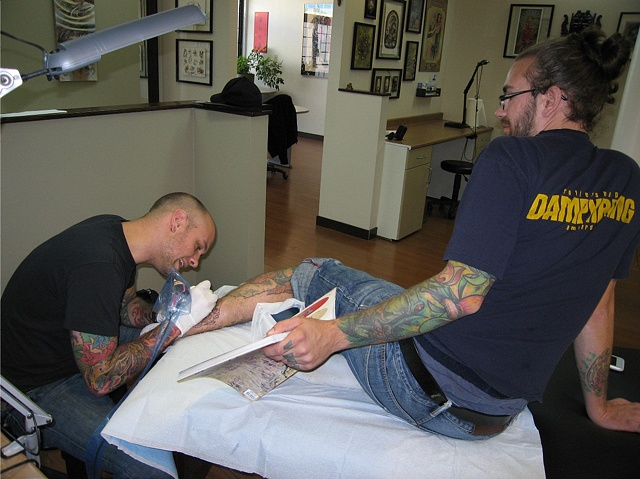 Ollie tattooing Shawn O'Connor