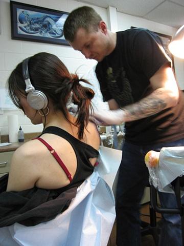 Simon Golygowski tattooing at Ink Machine Tattoo Edmonton Canada