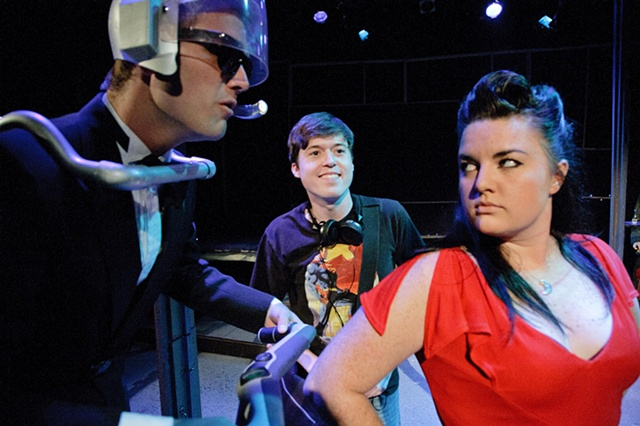 The characters inside Kyle's play, Spacebar, come to life for the first time as he looks on.