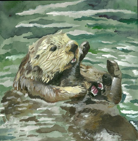Two sea otters enjoying each others company with a friendly tickle fight.