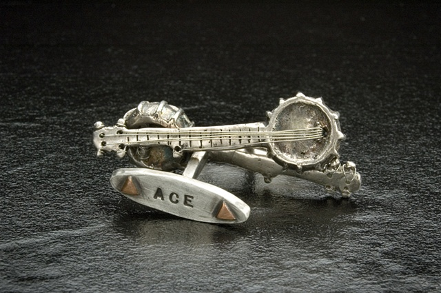 """Ace's Banjo Cufflinks"""