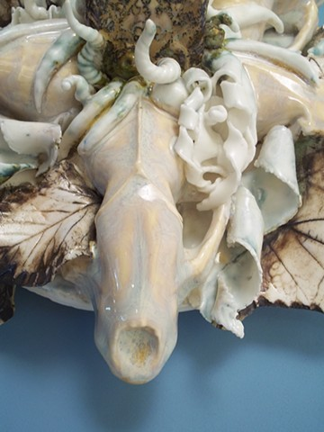 Parian, glazed ceramic sculpture with an MDF backdrop