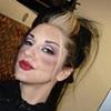 Makeup detail shot of Metal Sanaz modeling for Lip Service clothing