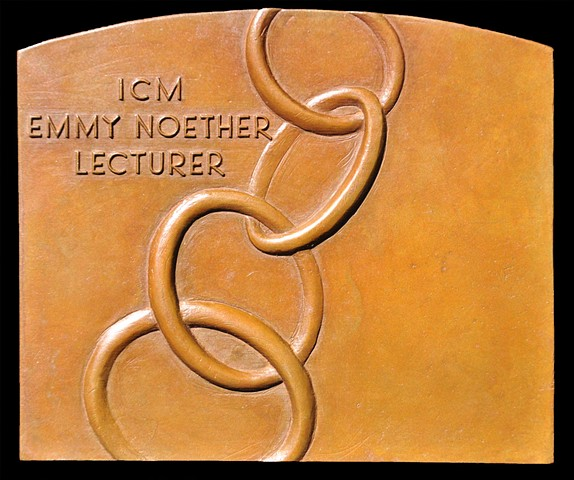 Reverse of the Emmy Noether Lecturer Plaquette.  The image is of Notherian rings.