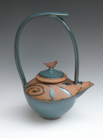 Teapot with tall handle, turquoise glaze, spirals, leaves and bird on lid