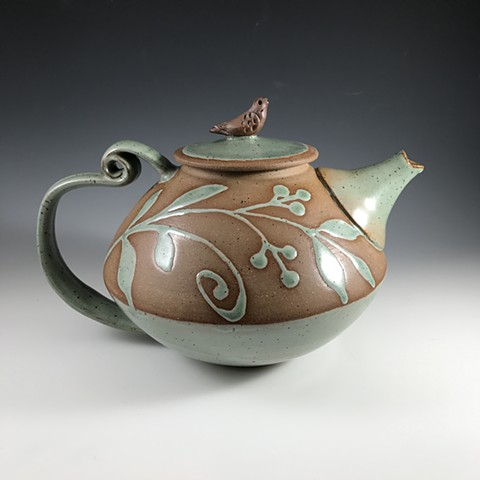 Curled back handle teapot