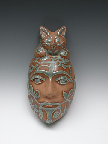 Cat mask, patina green