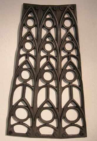 Cast iron wall sculpture with Gothic motif By Vaughn Randall