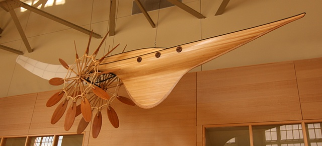 This large-scale ceiling hung mixed-media sculpture is constructed using wood, steel, and aircraft fabric.
