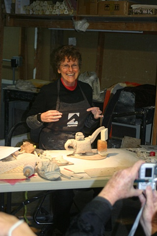 Lana working on a teapot  (CLICK ON IMAGE FOR LARGER PHOTO)