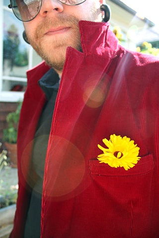 Yellow Flower, Red Jacket
