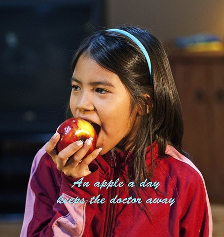 Girl eating apple, health benefits