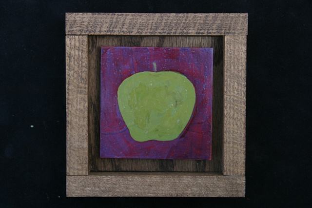 green apple on purple