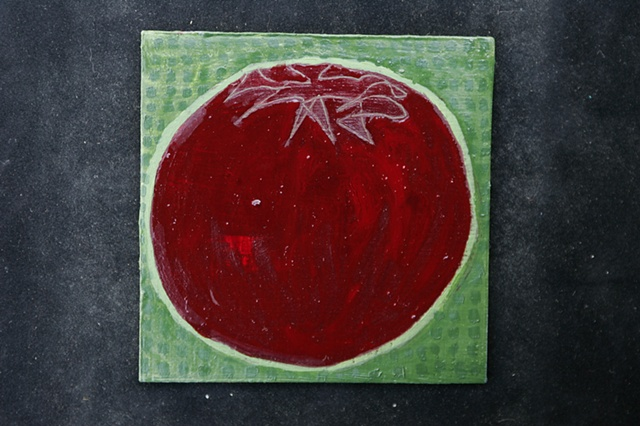red tomato on green squares